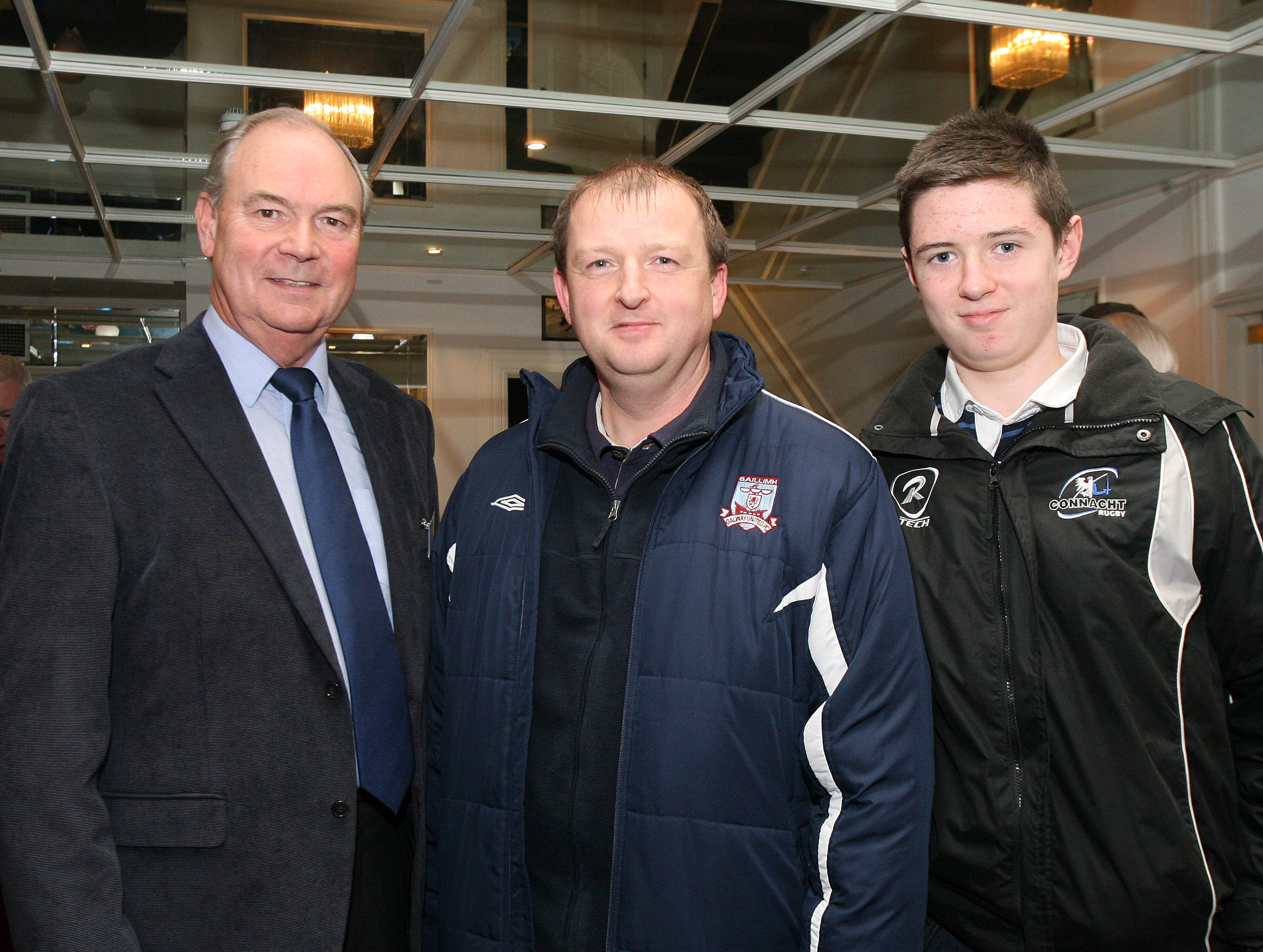 Cliff Rowe, committee member, with John and Seán Gilmore, Corrandulla, at the launch of the Galway Soccer Co-op supporting Galway United at Hotel Meyrick.