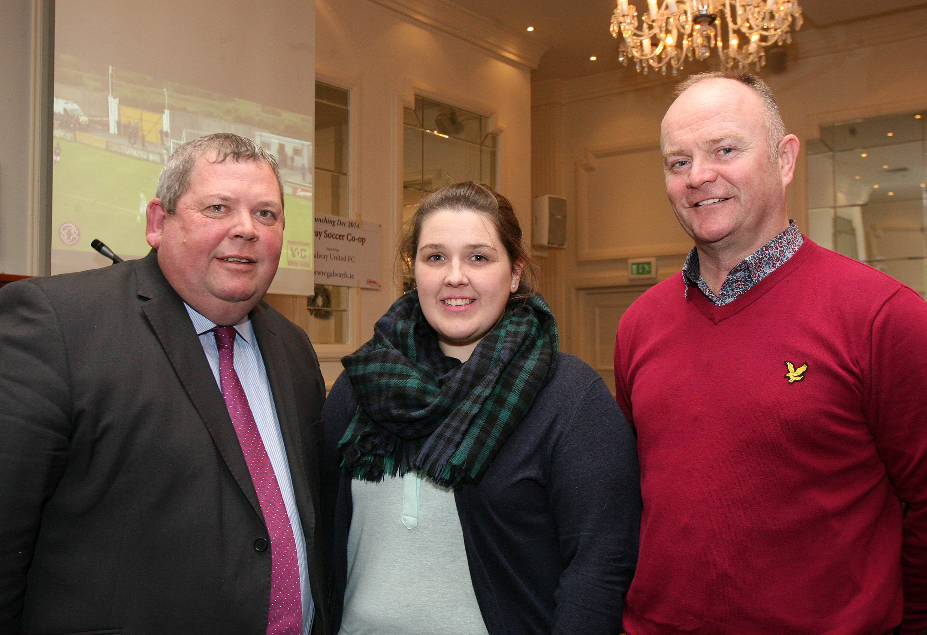 Eamonn and Lisa Naughton, Salthill, with Ricky O'Flaherty, soccer coach, at the launch of the Galway Soccer Co-op supporting Galway United at Hotel Meyrick.